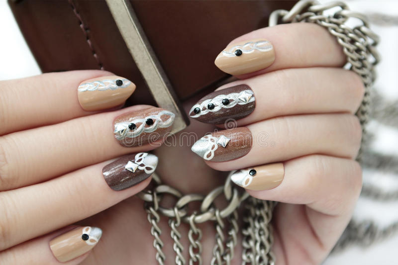 Manicure with chain. stock photo