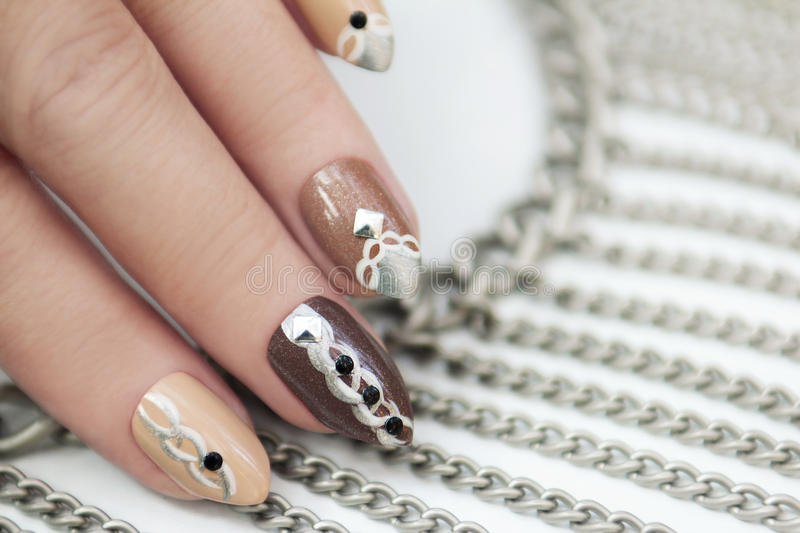 Manicure with chain. royalty free stock image