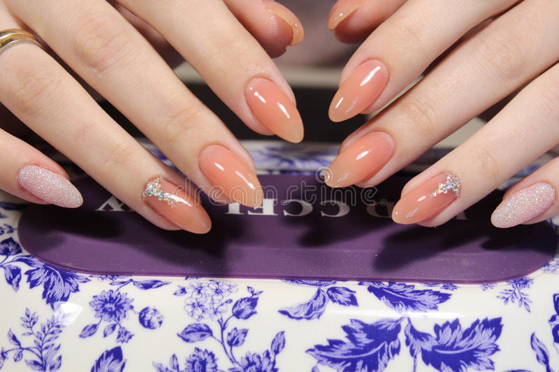 Manicure design of natural color royalty free stock photography