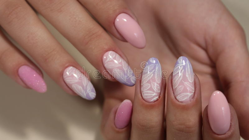 Manicure design with a pattern on the nails. Bast royalty free stock photography