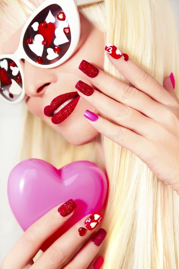 Manicure en make-up met harten royalty-vrije stock afbeelding