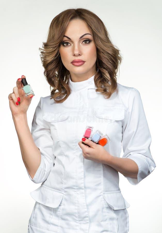 Manicure master holding nail polish. Nail master holding nail polish stock image