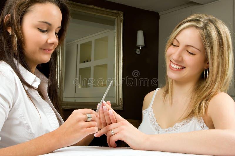 Manicure met een glimlach stock foto's