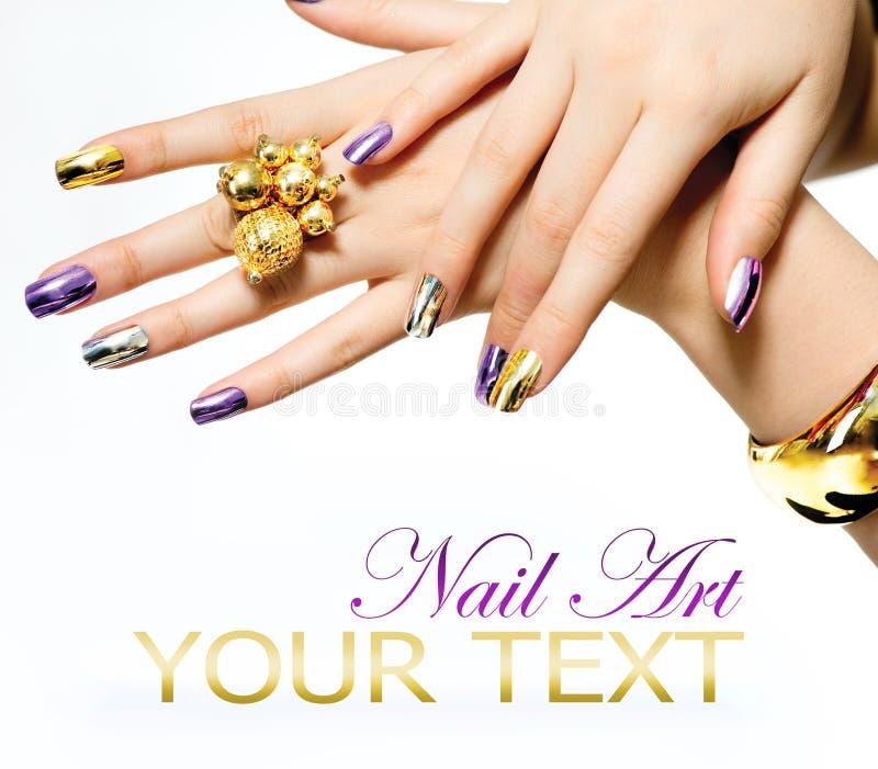 Manicure. Metallic Nail polish royalty free stock photography
