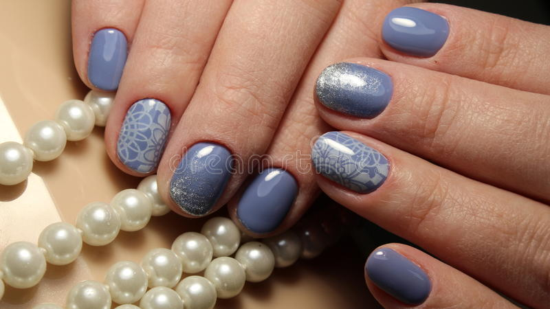 Manicure Nail Design Blue With Lace And Sequins Gradient Stock Image