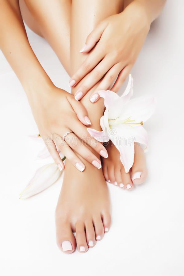 Free Manicure Pedicure With Flower Lily Close Up  On White Perfect Shape Hands Spa Salon Royalty Free Stock Photos - 161131538