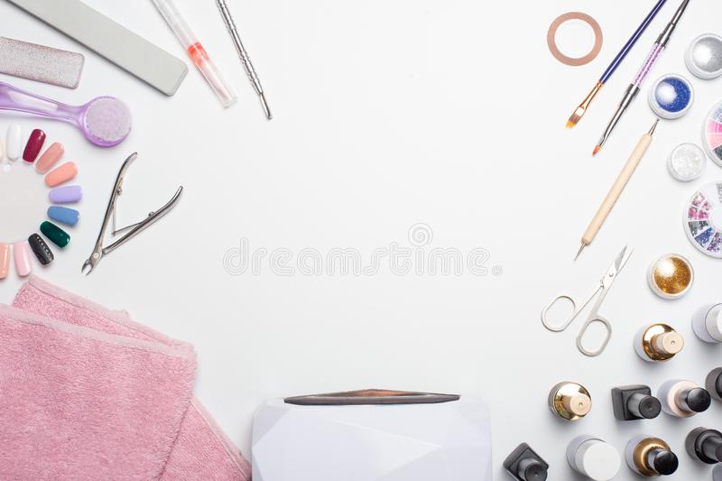 Manicure - tools for creating, gel polishes, all for the treatment of nails, the concept of beauty, care. Banner for inscription s royalty free stock photography