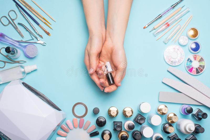 Manicure - tools for creating, gel polishes, care and hygiene for nails. Beauty salon, nail salon, mastira for working with nochts royalty free stock photography