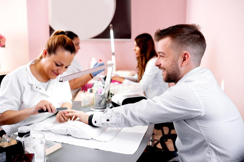 Manicure treatment with emery board stock photo