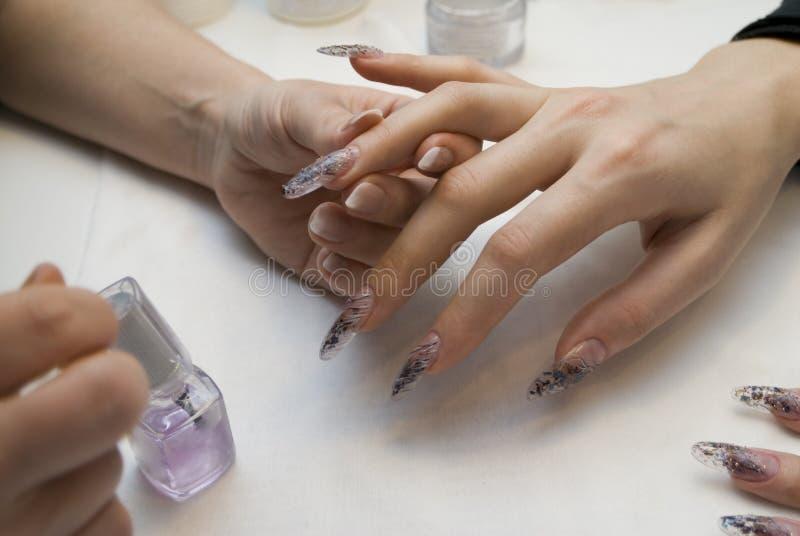 Manicure zijn spijkers. royalty-vrije stock afbeeldingen