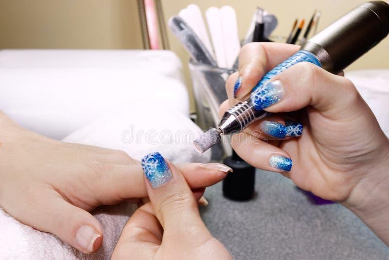 Manicurebehandling royaltyfri bild