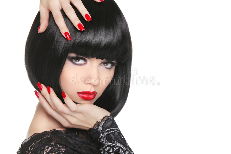 Manicured nails. Beauty girl portrait. Red lips. Back short bob. Hair. Hairstyle. Professional makeup royalty free stock photography