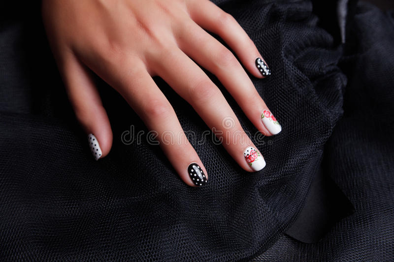 Manicured and painted nails. Manicured and beautiful painted nails with gel polish royalty free stock photos