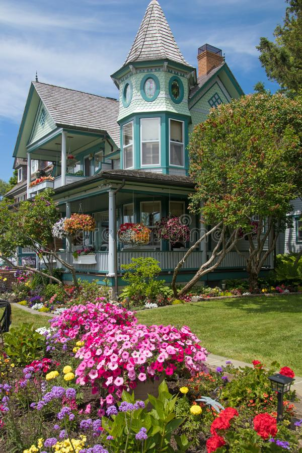 Victorian house with a manicured yard on Mackinac Island royalty free stock photography