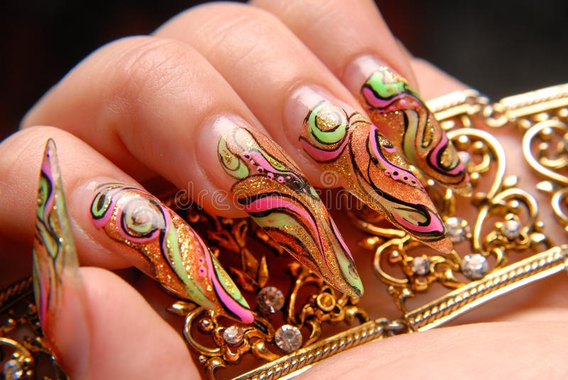 Manicures. Beautiful pattern on nails stock image