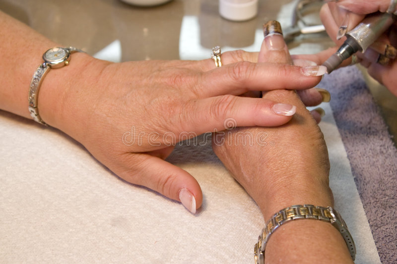 Manicurist Nail Technician royalty free stock images