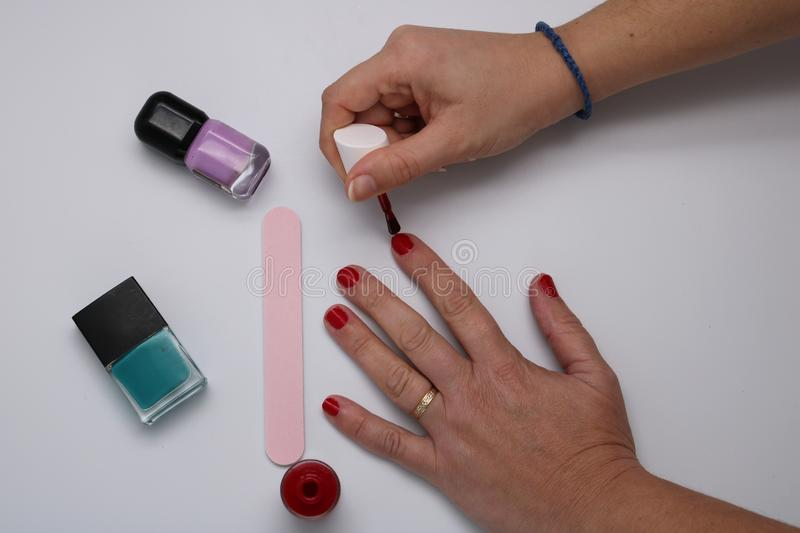 Manicurist painting nails royalty free stock photo