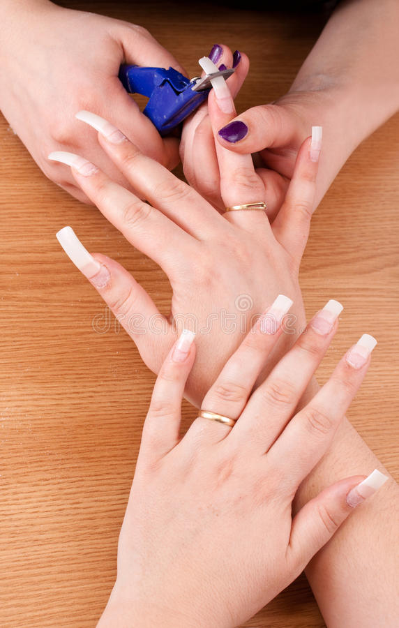 Manicurist Trimming Nail Royalty Free Stock Photography