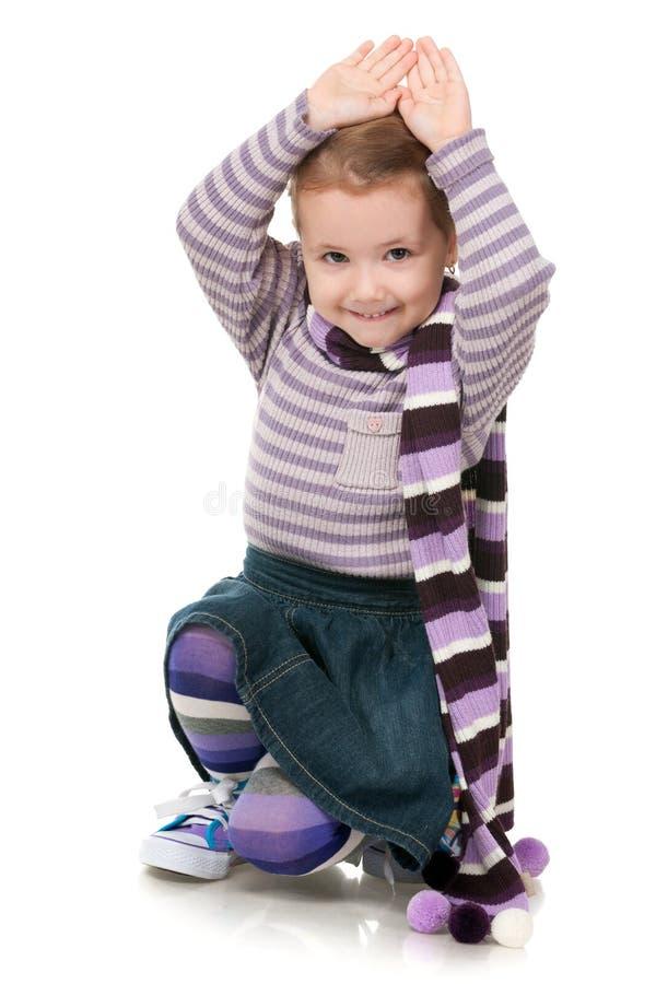 Maniermeisje in gestreepte sweater royalty-vrije stock afbeelding