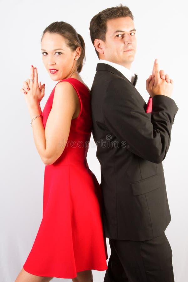 manierpaar op een witte achtergrond in studio het stellen als voor filmaffiche royalty-vrije stock fotografie