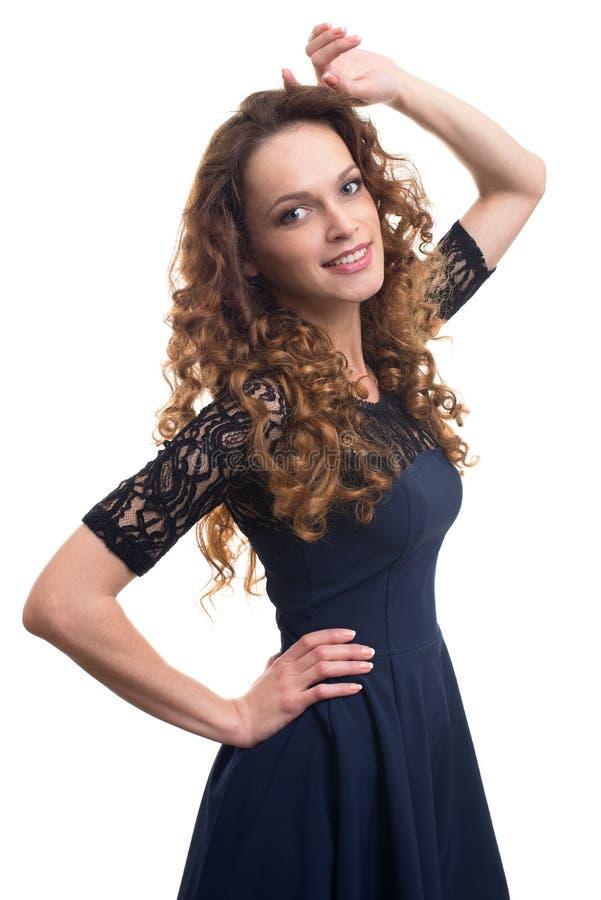 Manierportret van elegante vrouw met krullend haar stock foto's
