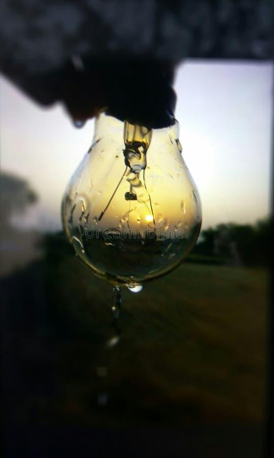 Manifestazioni del pic di Sun in una lampadina immagini stock