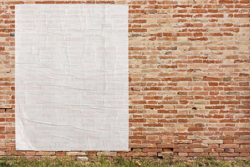 Manifesto vuoto sulla parete fotografia stock