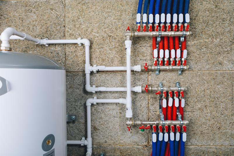 Manifold collector with pipes in boiler room. Close-up view stock photo