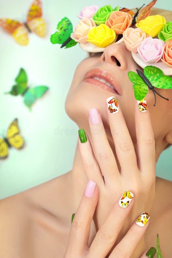Manikyr med fjärilar royaltyfri foto