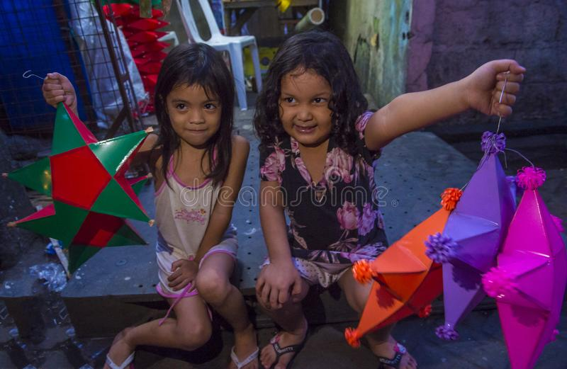 Manila Christmas market lanterns. MANILA , PHILIPPINES - DEC 14 : A Filipino girls holding a lantern in a Christmas market in Las Pinas city , Manila the stock photos