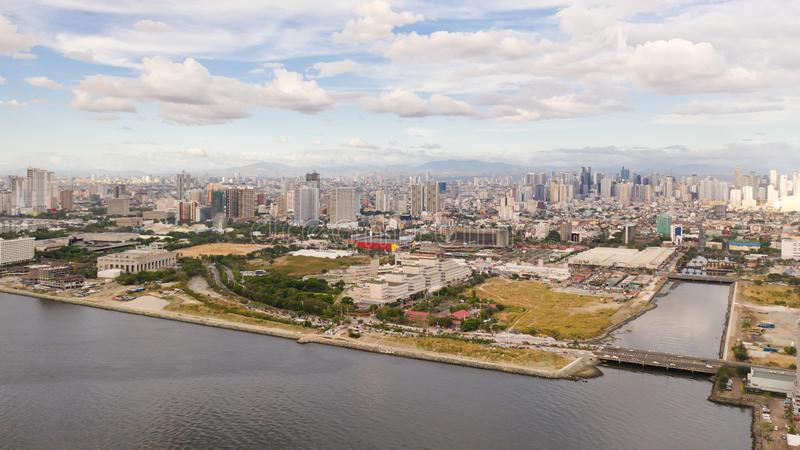 Manila city in the morning, view from above. Panorama of a large port city. City with modern buildings and skyscrapers royalty free stock image