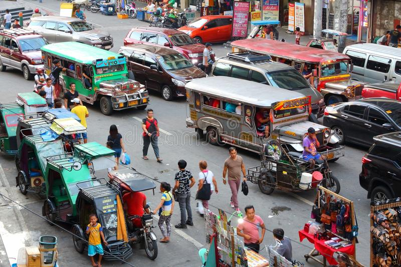 Manila jeepneys. MANILA, PHILIPPINES - NOVEMBER 25, 2017: People drive in heavy traffic in Manila, Philippines. Metro Manila is one of the biggest urban areas in royalty free stock photography