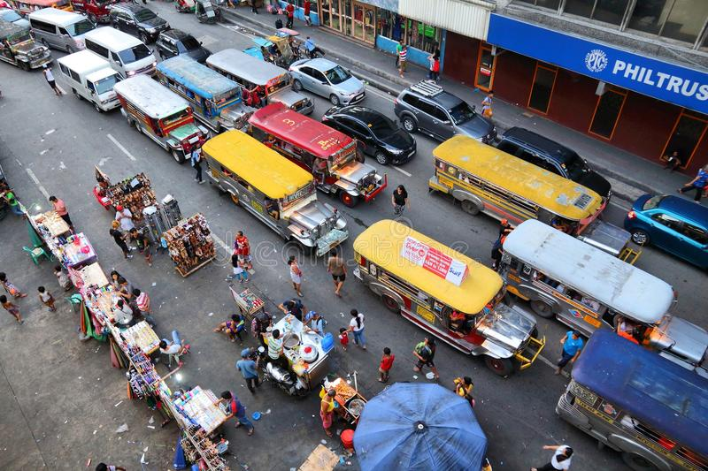 Manila jeepneys. MANILA, PHILIPPINES - NOVEMBER 25, 2017: People drive in heavy traffic in Manila, Philippines. Metro Manila is one of the biggest urban areas in royalty free stock images
