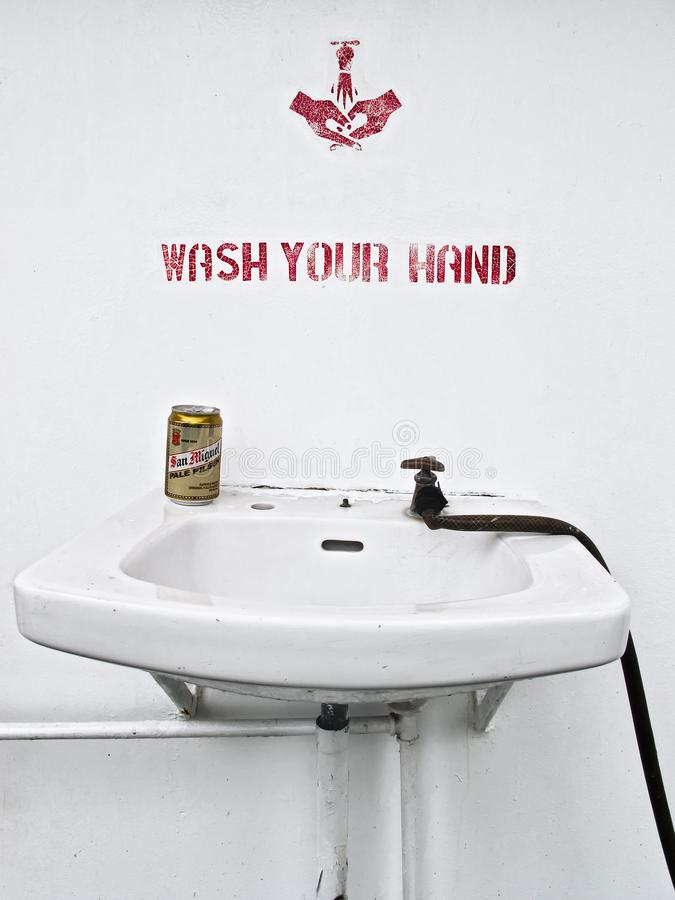 San Miguel Pilsen Beer can standing at a hand wash basin stock image