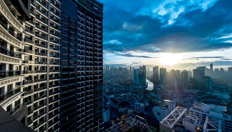 Spectacular day to night transition in Manila. MANILA, PHILIPPINES - CIRCA MARCH 2018: View on the Skyline of Makati circa March, 2018 in Manila, Philippines stock photo