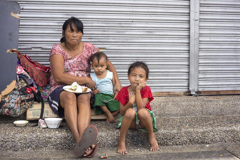 Homeless woman with her children royalty free stock photos