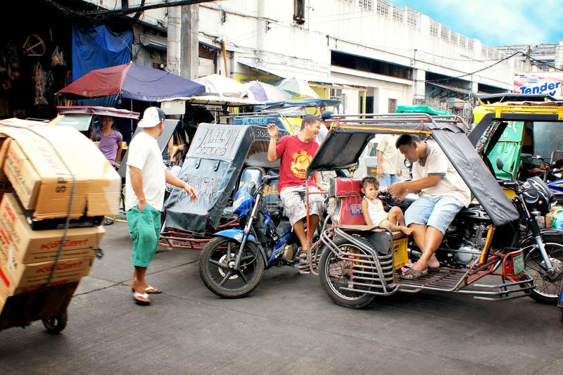 Road traffic in Manila, Philippines, with the typical tuk tuks royalty free stock photo