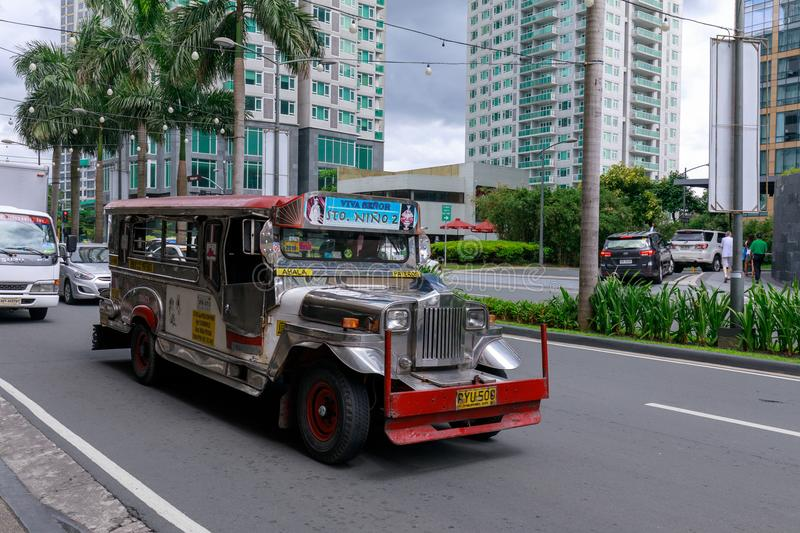 Jeepney, Philippines public transportation near Greenbelt shopping mall in Metro Manila royalty free stock image