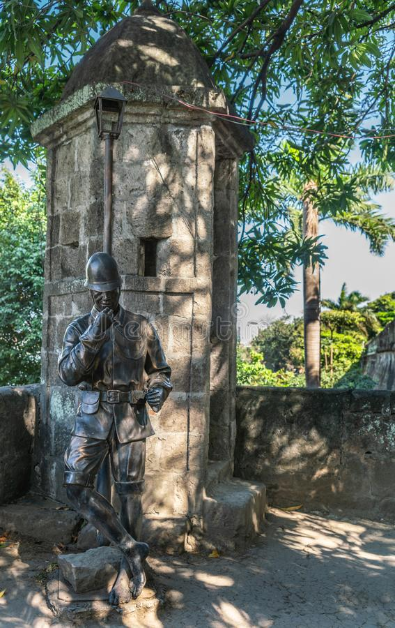 Statue of soldier at guard post in Fort Santiago, Manila Philippines. Manila, Philippines - March 5, 2019: Fort Santiago. Bronze statue of helmeted soldier royalty free stock images