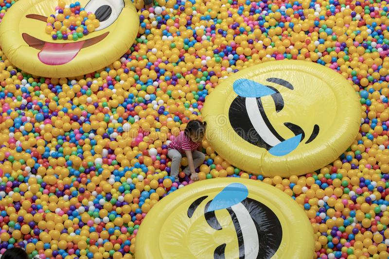 Manila, the Philippines - 22 March 2018: Girl plays in colorful balls, children`s playground in a shopping mall. stock photo