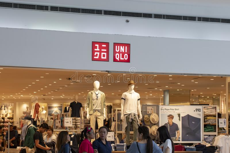 Manila, Philippines 22 March 2018: Uniqlo brand name on store entrance in SM Mall of Asia shopping mall. Modern fashion store label. Casual wear shop. Asian stock images