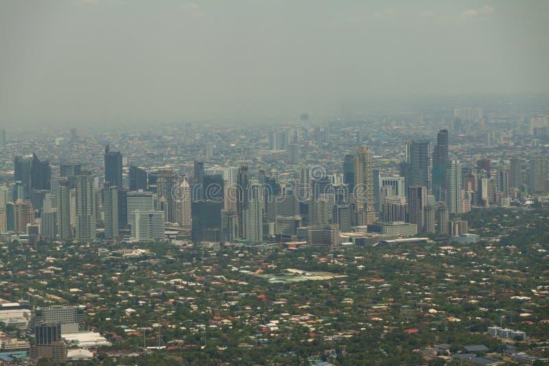 Manila sikt från flygplanet, Filippinerna arkivfoto