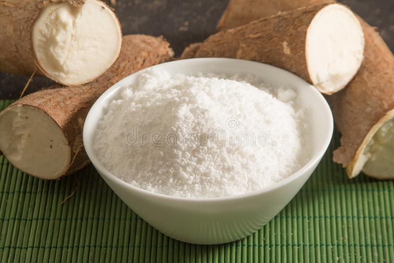 Manioc Tapioca Flour in a bowl. Over a wooden table stock images