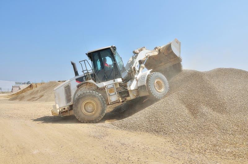 Manipuleer de bulldozer van het rupsbandwiel stock foto