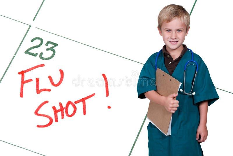 Manipulera lite skjuten influensa arkivbild