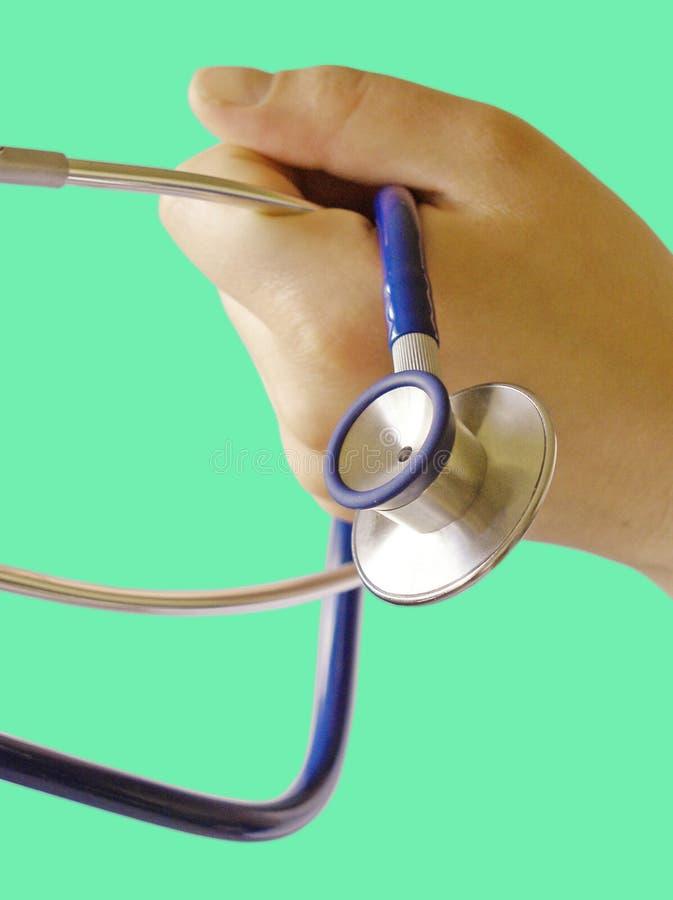 Manipulera med stetoskopet royaltyfria foton