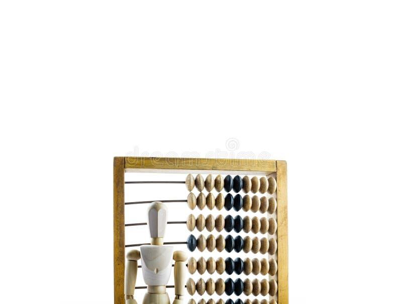 Maniquí de madera con el ábaco de madera foto de archivo libre de regalías