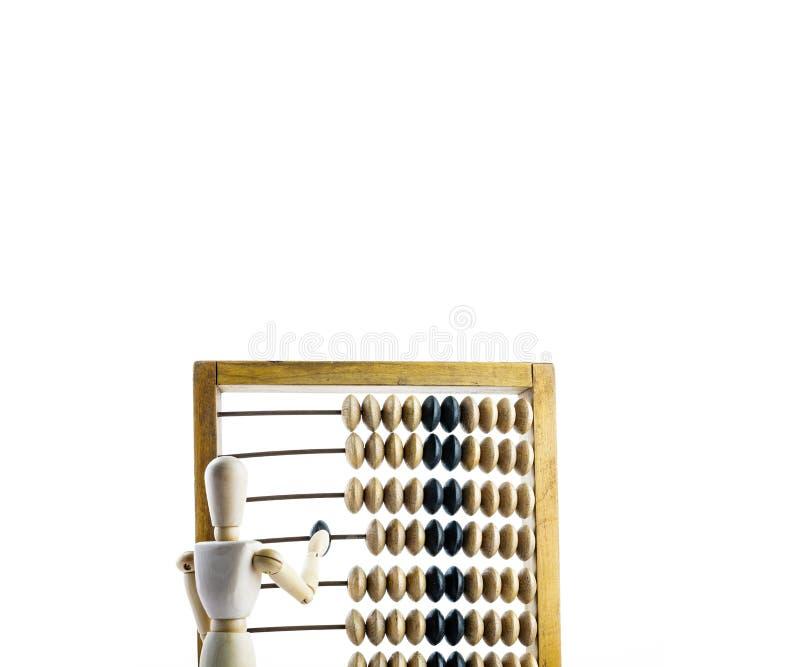 Maniquí de madera con el ábaco de madera imagen de archivo
