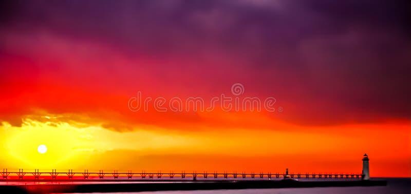 Manistee norr Pierhead fyr på solnedgången arkivbild