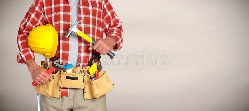Manitas del constructor con las herramientas de la construcción imagenes de archivo